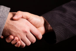 Two businessman handshakes